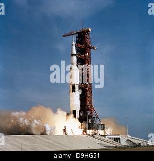 Apollo 11 space vehicle taking off from Kennedy Space Center. - Stock Photo