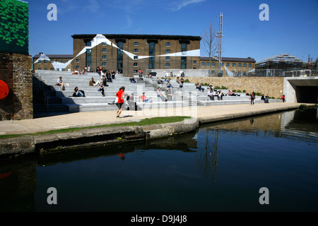 View across the Regent's Canal to the Granary Building on Granary Square, King's Cross, London, UK - Stock Photo