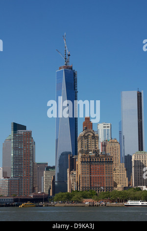 The Word Trade Center construction set against a clear blue sky on May 27, 2013 in New York, NY, USA. - Stock Photo