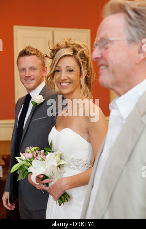 Bride, groom and bride's father at wedding ceremony - Stock Photo