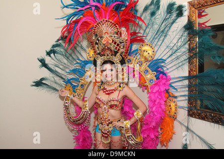 Young woman wearing a traditional fantasy carnival costume in Panama. - Stock Photo