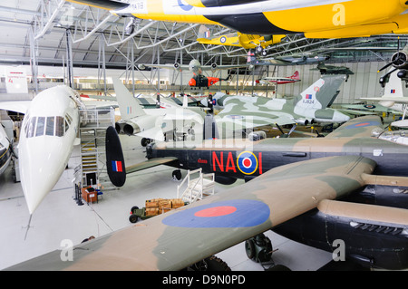 Main hangar at Duxford Imperial War Museum with a selection of aircraft - Stock Photo