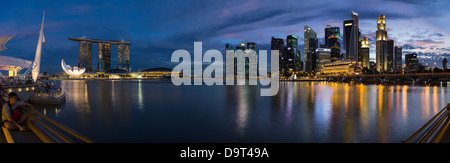 the skyline at night from the Esplanade with Marina Bay (left) and the Central Business District (right), Singapore - Stock Photo