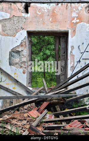 Open Door And Broken Window Of Old Abandoned Factory