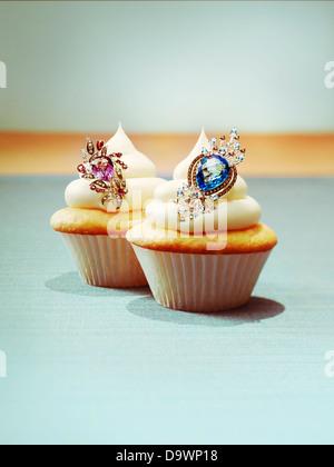 Cupcakes with jewelry - Stock Photo