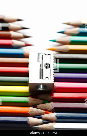 Row of colored pencils in perspective with sharpener on top - Stockfoto
