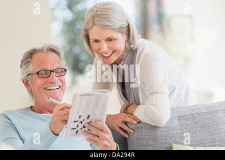Senior couple doing crossword - Stock Photo