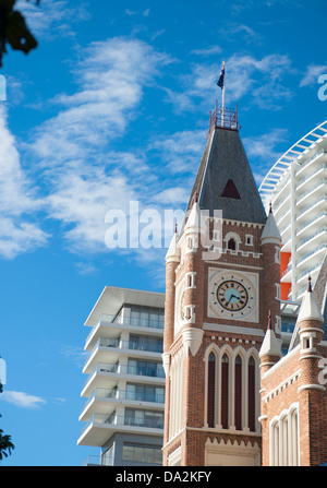 The tower of convict-built town hall at Hay Street against the facade of a modern skyscraper at Perth, Western Australia - Stock Photo