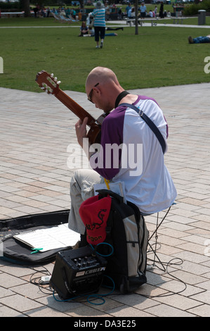 Classical guitar busker, Stratford-upon-Avon, UK - Stock Photo