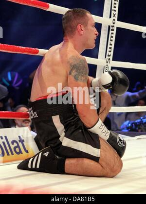 Dortmund, Germany. 6th July, 2013. Middle-weight boxing pro Predrag Radosevic of Montenegro kneels on the floor - Stock Photo