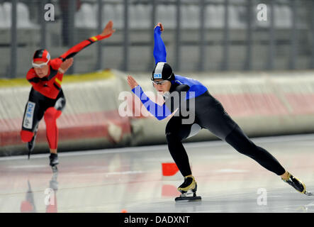 German speed skaters Jenny Wolf (R) and Gabriele Hirschbichler skate in the first heat of the women's 500 meter - Stock Photo