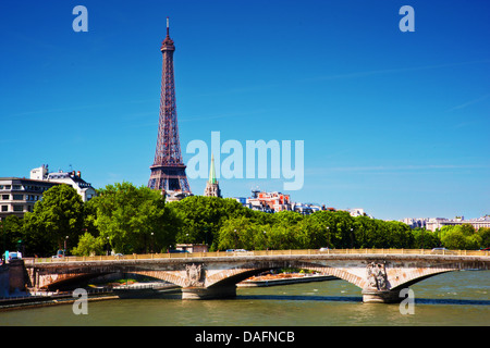 Eiffel Tower and Pont Des invalides bridge on Seine river in Paris, France. View from Alexandre Bridge at sunny - Stock Photo