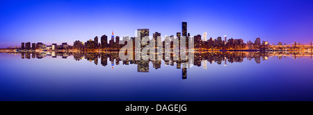Midtown Manhattan skyline across the East River in New York City. - Stock Photo