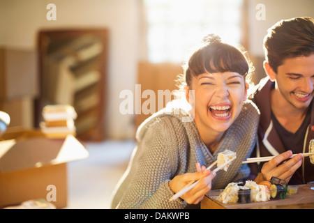 Couple eating sushi together - Stock Photo