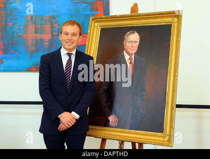 Pierce Bush (L), the grandson of George Bush stands next to the honorary cititen portrait of former USPresident - Stock Photo