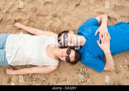 teens laying on the beach