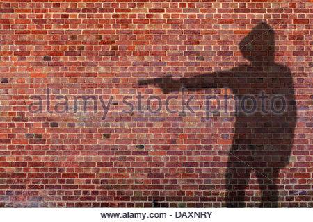 gun man shadow - Stock Photo