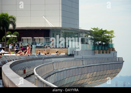 People relaxing at Marina Bay Sands Infinity Pool - Stock Photo