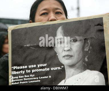 A photo of Aung San Suu Kyi (bottom), detained leader of the nonviolent democracy movement in Myanmar and Nobel - Stock Photo
