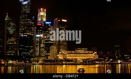 Night view of Singapore's Central Business District and the Fullerton Hotel from across the Marina Bay area - Stock Photo
