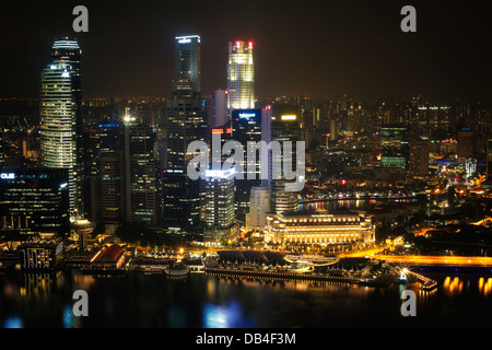 Night view of Singapore's Central Business District from the atop the Marina Bay Sands' viewing platform - Stock Photo