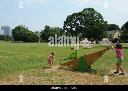 A seesaw-like sculpture by Michael Borowski is part of the Figment art installation on Governors Island for the - Stock Photo