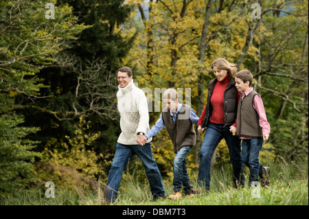 Family Walking In Forest, Bavaria, Germany, Europe - Stock Photo