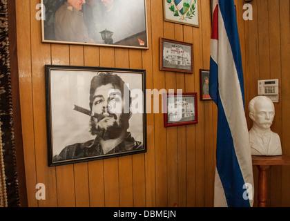 Photos on a wall in Havana Cuba of Fidel Castro - Stock Photo