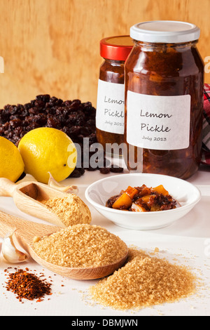 Home Made Chutney - home made lemon pickle, and ingredients - lemons, raisins, ginger, brown sugar, garlic and chilli. - Stock Photo