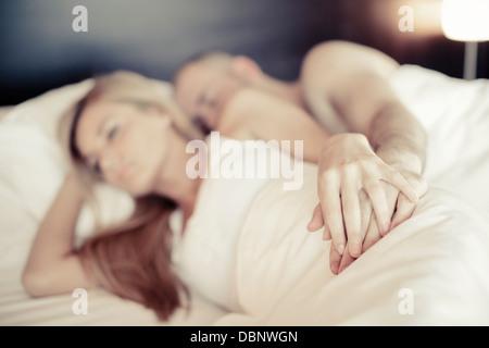 Young Couple Lying In Bed, Osijek, Croatia - Stockfoto