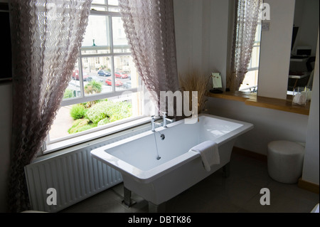 Bedroom Of Hotel With Bath Under Window In Brighton East Sussex Stock Photo Royalty Free Image