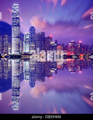 Hong Kong, China skyline from Victoria Harbor. - Stock Photo
