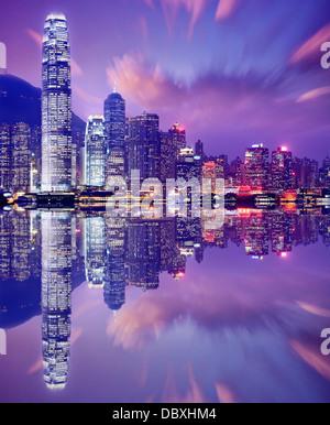 Hong Kong, China skyline from Victoria Harbor. - Stock Photo