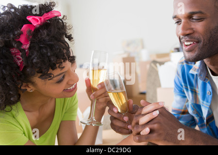 Mid adult couple toasting with champagne - Stock Photo