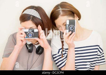 Two women taking photograph - Stock Photo
