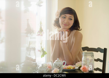 Woman day dreaming at tea time - Stock Photo
