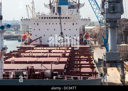 Bulk carrier discharging cargo. Southampton Docks. UK. COSCO BULK CARRIER - Stock Photo