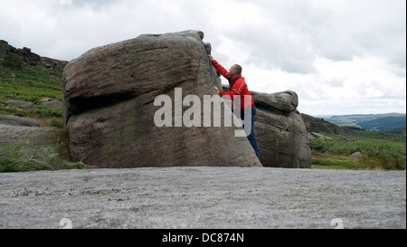 rock climber bouldering at Burbage Edge South, Derbyshire, Peak District National Park, England, UK, United, Kingdom, - Stock Photo