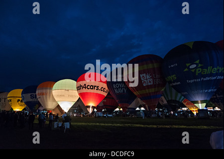 Bristol international balloon festival fiesta evening balloon night glow 2013 august 8th to music - Stock Photo