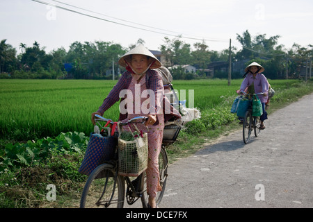 Two Women Riding Bicycles - Stock Photo