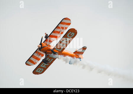 Eastbourne, Sussex, UK. 15th August 2013.  The Breitling Wingwalkers perform on 1940s Boeing Stearman biplanes on - Stock Photo