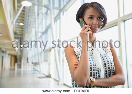 Business woman using smart phone - Stock Photo