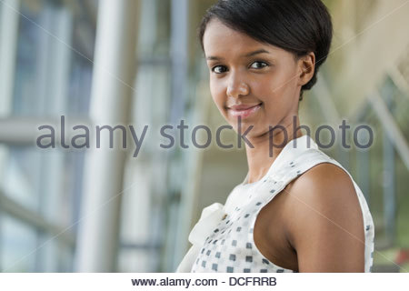 Portrait of smiling businesswoman in office - Stock Photo