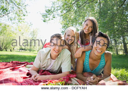 Portrait of happy teenage friends outdoors - Stock Photo