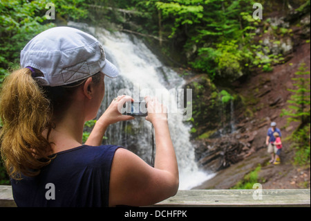 Mother taking photograph of her husband and son at Fuller Falls New Brunswick - Stock Photo