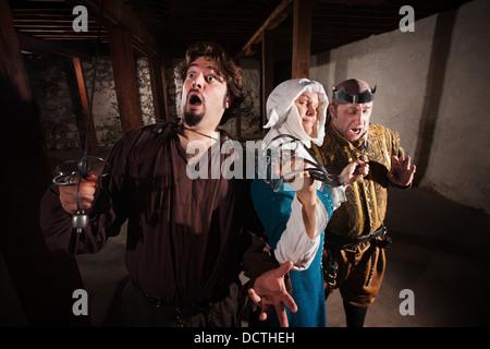 Nun Fighting Two Men - Stock Photo