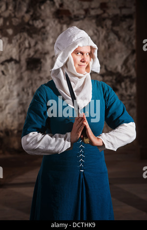 Grinning Nun with Knife - Stock Photo