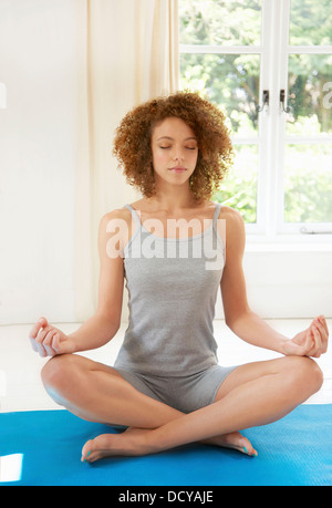 Woman Practicing Yoga in the Easy Pose - Stock Photo