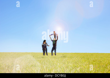 Family Playing on Field - Stock Photo