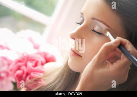 Teenage Girl Having Eyeshadow Applied - Stock Photo